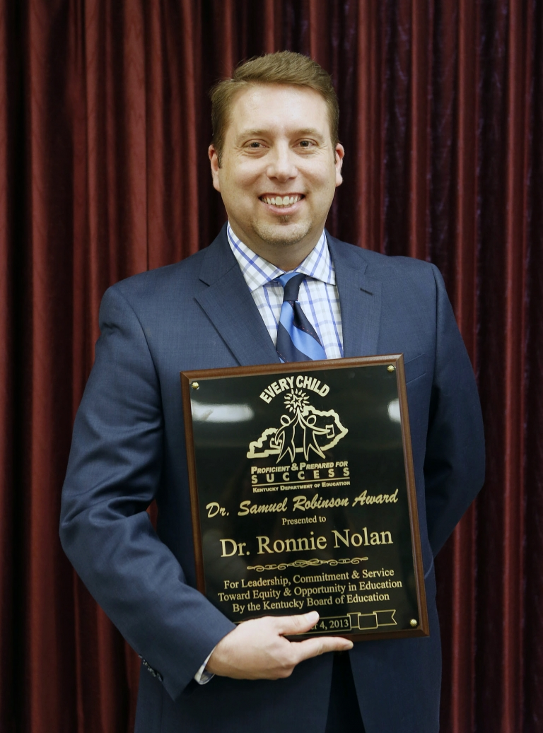Dr. Ronnie Nolan with the Dr. Samuel Robinson Award